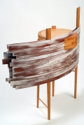 Abstract table with arc planks going through one side