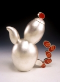 Tea kettle with ballooning shapes and red tail