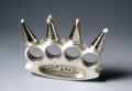 Brass knuckles with frosting nozzle spikes