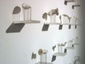 White, miniature sculptures on wall shelves