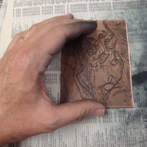 Michele Burgess holding a copper plate.
