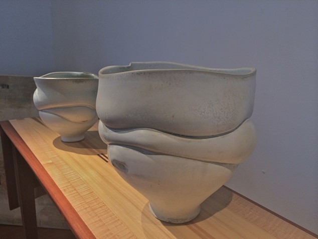 Ceramic vase with the appearance of sagging drapery