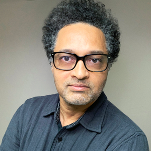 Male in black glasses and dark blue shirt