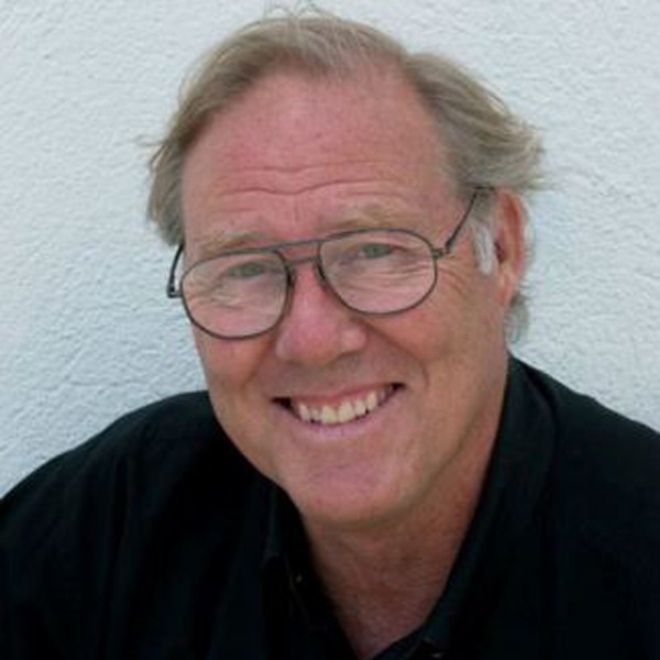 Man in black shirt and glasses