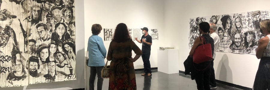 Poeple attending lecture in art gallery