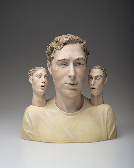 Ceramic bust of man with a head on each shoulder