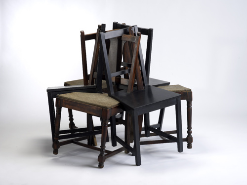sculpture of multiple interlocking chairs