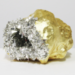 Sculpture of lumpy gold with silver confetti-like opening