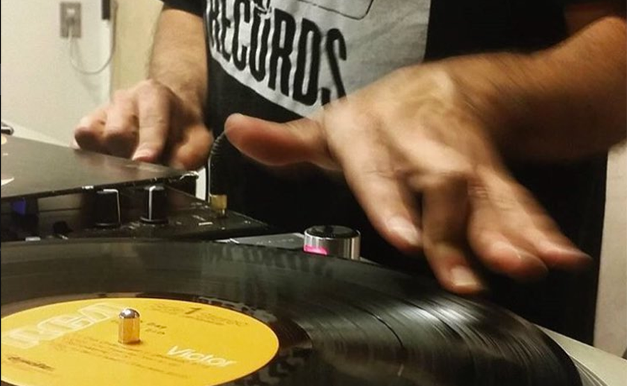 DJ spinning record with left hand